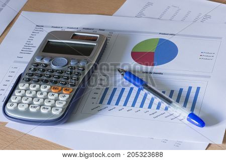 Office supplies and accounting documents on the table
