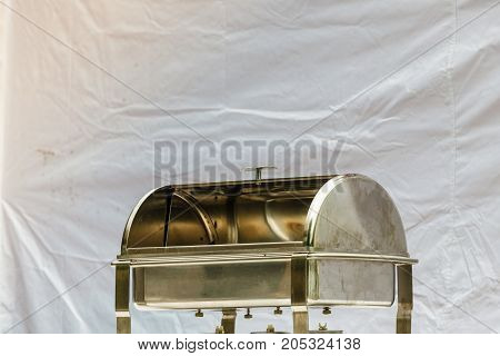 Slow cooking objects concept. Empty food container bain marie made of steel