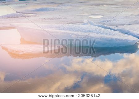 Sunlight effect over Ice lake with blue sky reflection Iceland natural landscape background