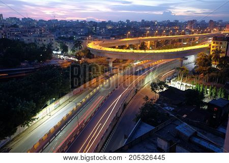 city overpass at night, circular flyover and traffic light intersection in bangladesh.
