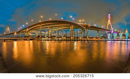 Panorama Twin suspension bridge connect highway intersection at twilight river front