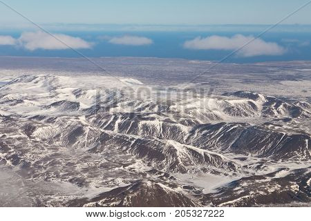 Iceland mountain landscape aerial view on the air plain in winter season background