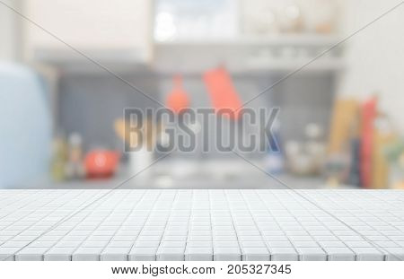 White ceramic mosaic tile table top and blurred kitchen interior background - can used for display or montage your products.