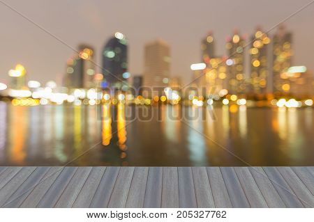 Opening wooden floor Office building blurred bokeh light water front abstract background