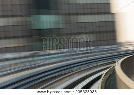 Blurred motion train moving track curved abstract background