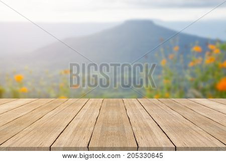 Empty wooden table top on blurred background at phu pa por mountain space for montage products