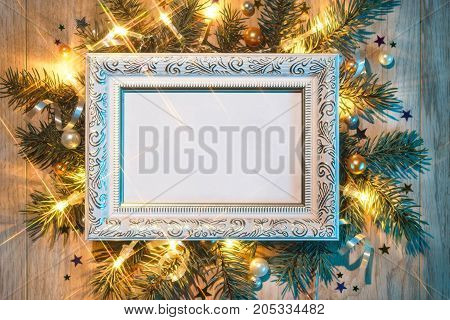 Christmas fir tree with white festive frame. Merry Christmas and Happy New Year!! Top view. High resolution product