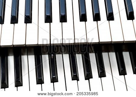 Parts of two classical music keyboard close up