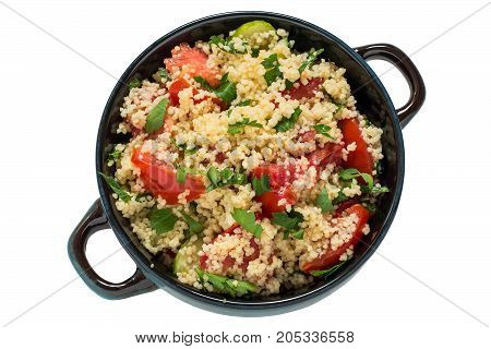 Bowl with couscous vegetables and herbs on white background. Traditional food in cuisine of Maghreb. Dietary and healthy food. Top view copy space