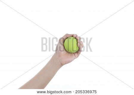 woman holding green stress ball on white background