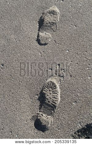 Footprints Of Shoes On A Sandy Beach