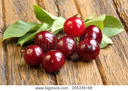 Cherry on an old retro wooden background