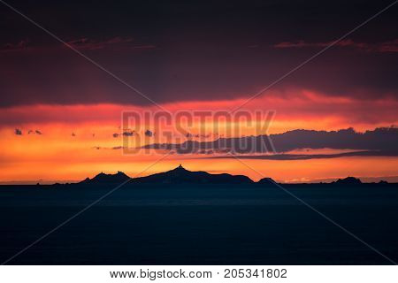 Iles Sanguinaires Silhouetted Against A Dramatic Orange Sunset