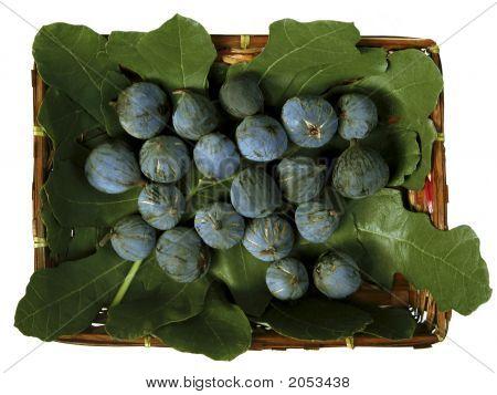 Ripe Purple Figs In A Basket