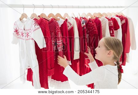 Clothes Rack With Red Christmas Knit Wear