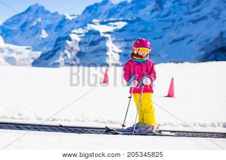 Child In Ski School. Snow Winter Fun In Mountains.