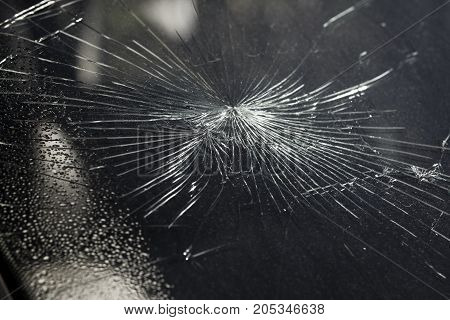A Broken Car Windscreen at an Accident Site