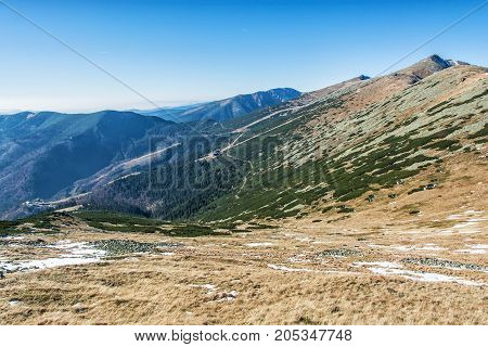 Lift station in Low Tatras mountains. Cable car to the Chopok peak. Valley with coniferous forest. Natural scene. Travelling theme.