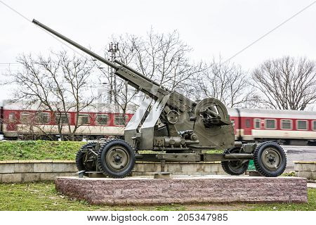 Anti-aircraft machine gun of the World war II. War industry. Personal train in motion. Weapons theme. Exposed artillery.
