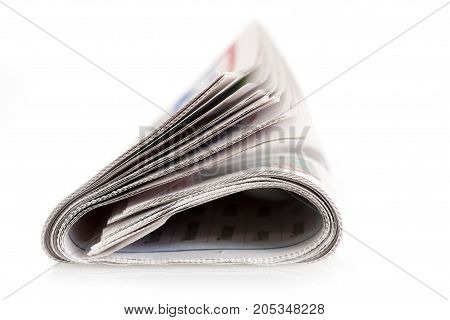 Closeup of the daily newspaper on a white background