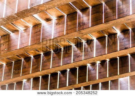 View of a wooden floor from beneath on sunshine