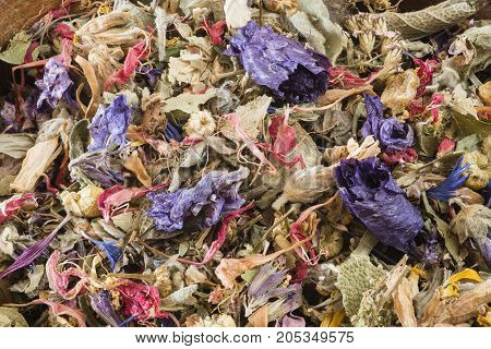 Wooden bowl with potpourri of dried flowers and leaves.