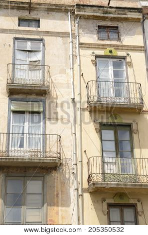 Balconies on deteriorate building in Figueres a city of Girona Catalonia Spain.
