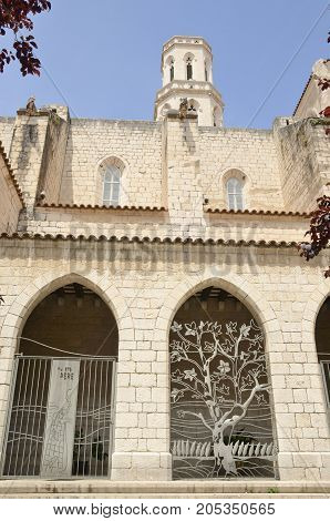 Arches on facade of Saint Peter church in Figueres a city of Girona Catalonia Spain.