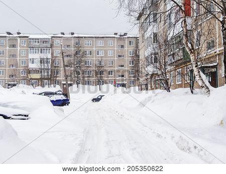GUBAKHA PERM KRAI RUSSIA - MARCH 2 2017: Huge snowdrifts in the courtyard after a snowfall