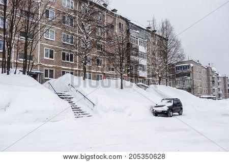 Russian Winter. Huge Snowdrifts In The Courtyard