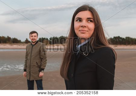 young loving couple on the seashore in autumn