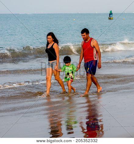 Family Walks On Beach, In Salinas, Ecuador