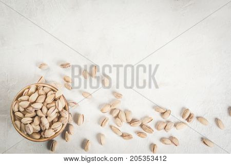 Pistachio Nuts On A White Stone Table