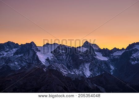 Colorful Sky At Dusk Beyond The Glaciers On The Majestic Peaks Of The Massif Des Ecrins (4101 M), Fr