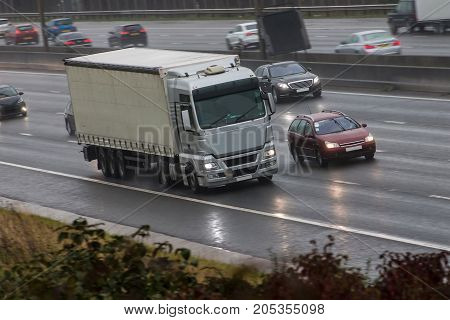 Lorry in motion on the motorway in a bad rainy weather