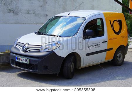 Kamnik, Slovenia - July 30, 2017: Slovenian postal car, The Post of Slovenia (Slovene: Pošta Slovenije). The Post of Slovenia is a state-owned company responsible for postal service in Slovenia.
