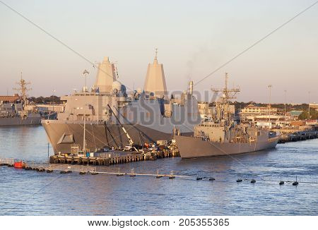 The navy base ships in a sunset light outside Norfolk town (West Virginia).