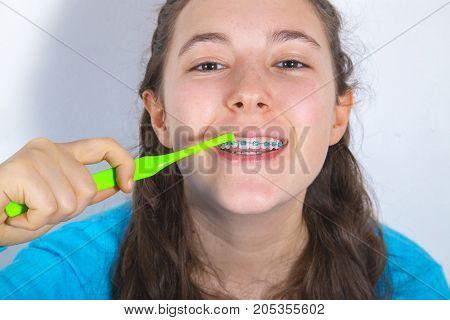 Smiling Teenage Girl With Teeth Braces