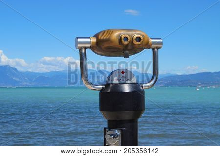 Peschiera del Garda, Italy - August 12, 2017: Binocular viewer of Lake Garda in the city of Peschiera del Garda.