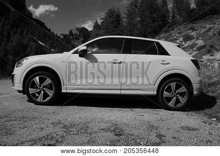 Kranjska Gora, Slovenia - August 11, 2017: Yellow Audi A3 4wd parked by the side of the road. Nobody in de vehicle.
