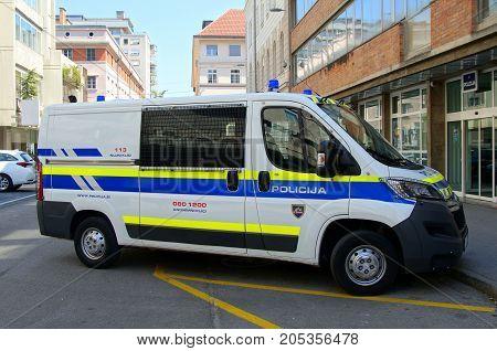 Ljubljana, Republic of Slovenia -  August 5, 2017: Slovenian National Police van (Policija), parked on a public parking lot in city of Ljubljana.