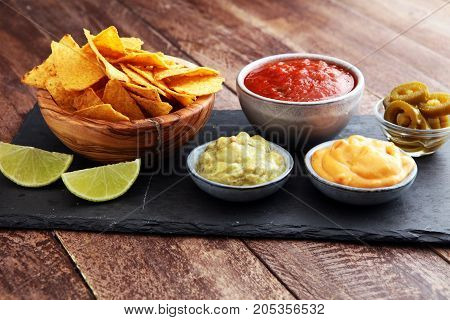 Nachos Tortilla Chips And JalapeÒos Chili Peppers Or Mexican Chili Peppers With Tomato, Cheese And G