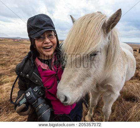 Photographer With Icelandic Horse