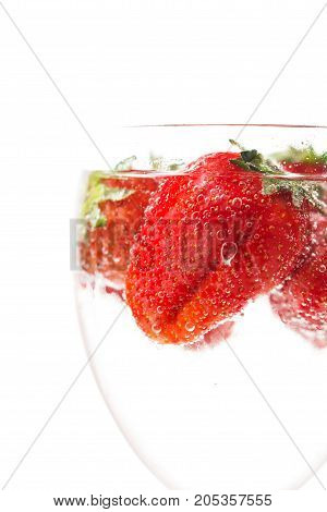 Ripe Juicy Red Strawberry In A Glass With Water