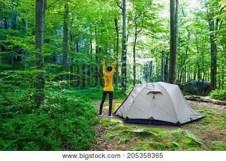 The Girl Is Standing Near The Tent.