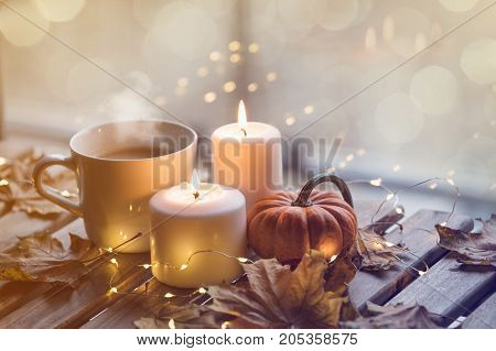 Cup Of Coffee Or Tea Near A Pumpkin And Candles