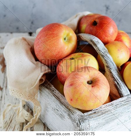 Wooden box with fragrant ripe apples Fruit Basket Organic