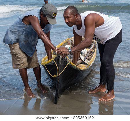 Fishermen Bringing In Boat