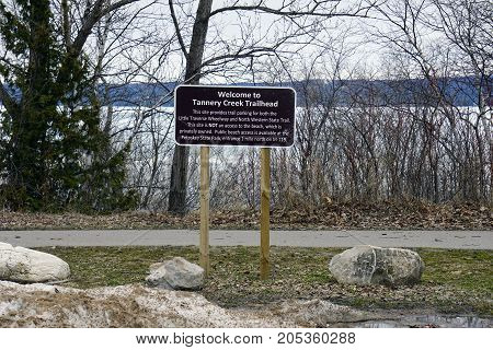 BAY VIEW, MICHIGAN / UNITED STATES - MARCH 30, 2017: Public parking is available at the Tannery Creek Trailhead, for both the Little Traverse Wheelway and the North Western State Trail.
