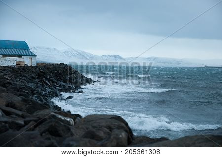 Waves At The Coast Of Hrisey In Iceland During A Winter Storm